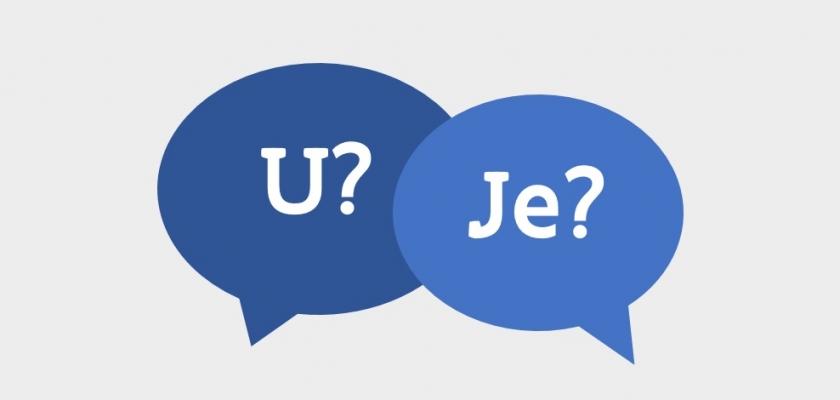 tekstballonnen met 'U?' en 'Je?'