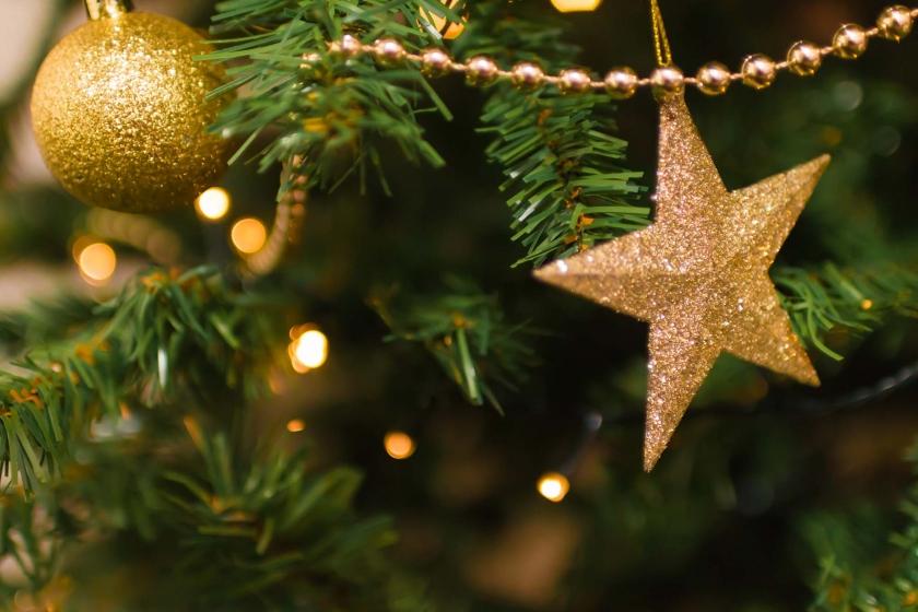 Gouden ster in kerstboom