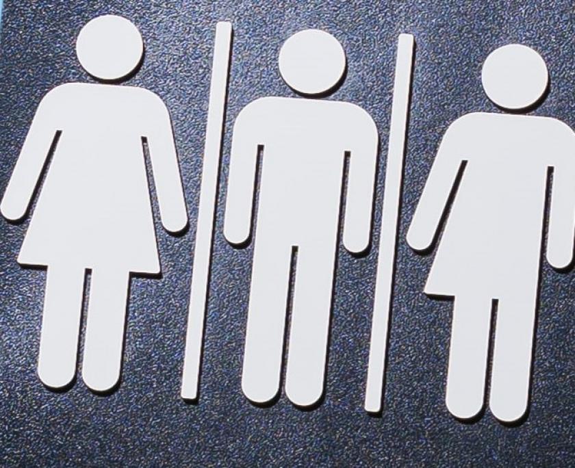Afbeelding met gender symbolen voor man/vrouw/non-binair